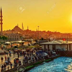ISTAMBUL,TURKEY- MAY 07, 2016:  Istanbul View of the sunset in the rays of the sun. People on the promenade. Istanbul is the largest city in Turkey.